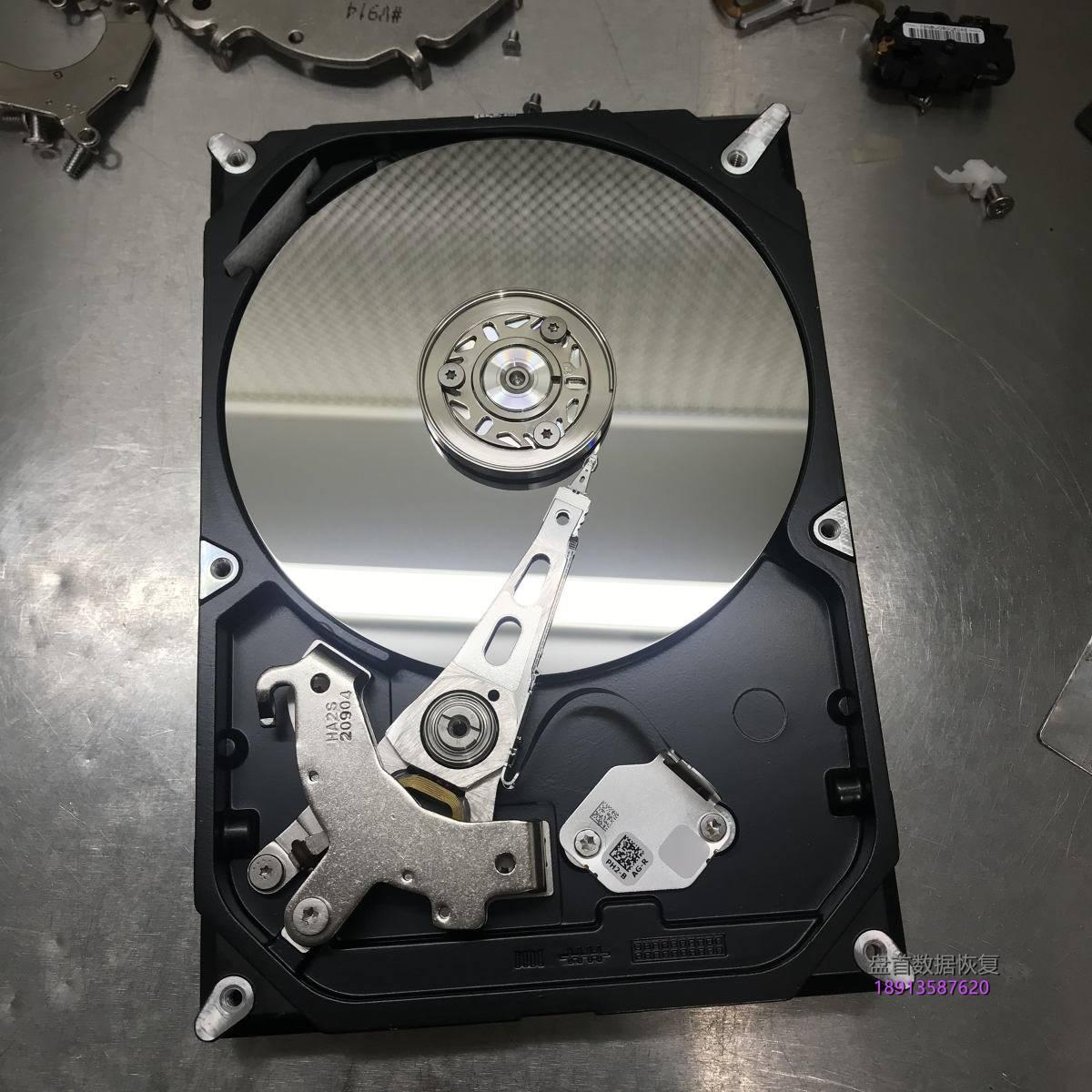 希捷ST500DM002磁头异响损坏敲11声停转,开盘数据恢复成功