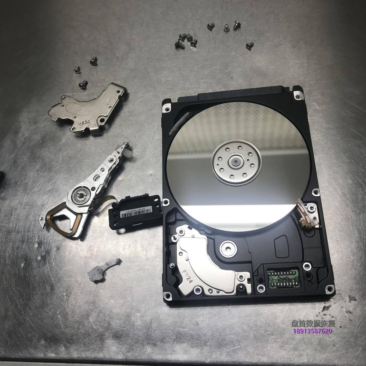 希捷1TB移动硬盘磁头卡死导致电机无法启动ST1000LM024开盘数据恢复成功